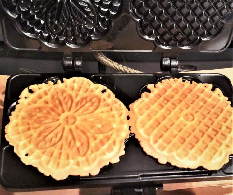 making pizzelle on a pizzelle iron for Pizzelle Cannoli with Ricotta Filling