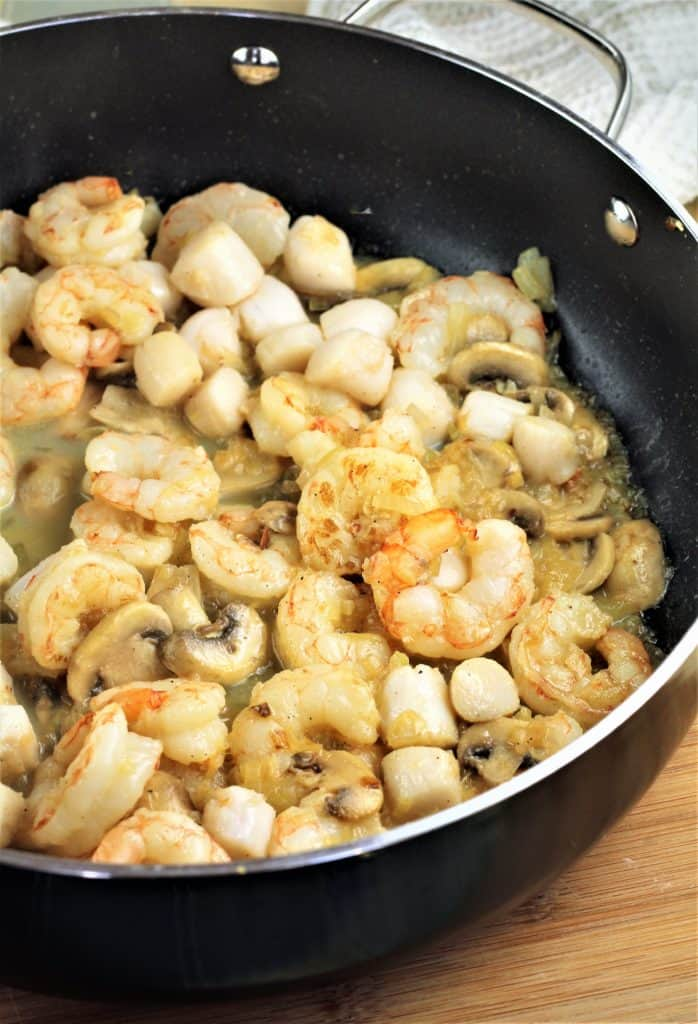 sauted scallops and shrimp in skillet