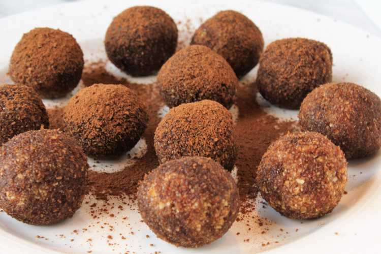 cocoa dusted date and nut truffles in a plate