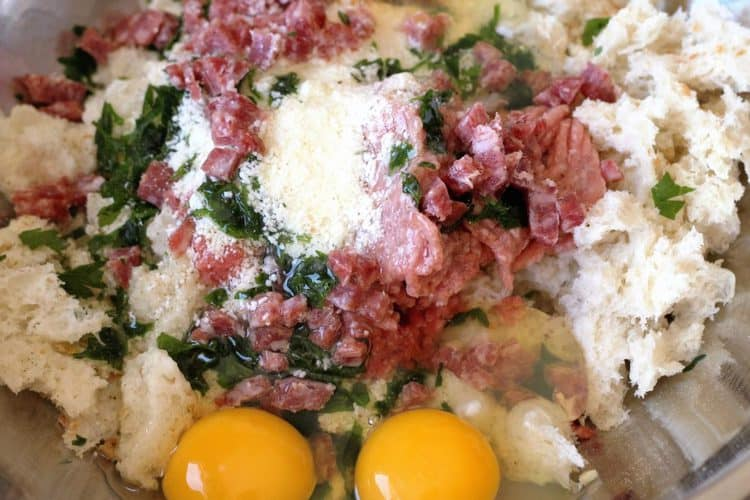 bread crumbs, ground meat, cheese, parsley and eggs in a bowl