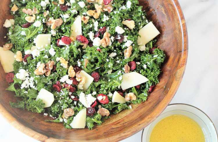 Kale Salad with walnuts, dried cranberries, walnuts and feta
