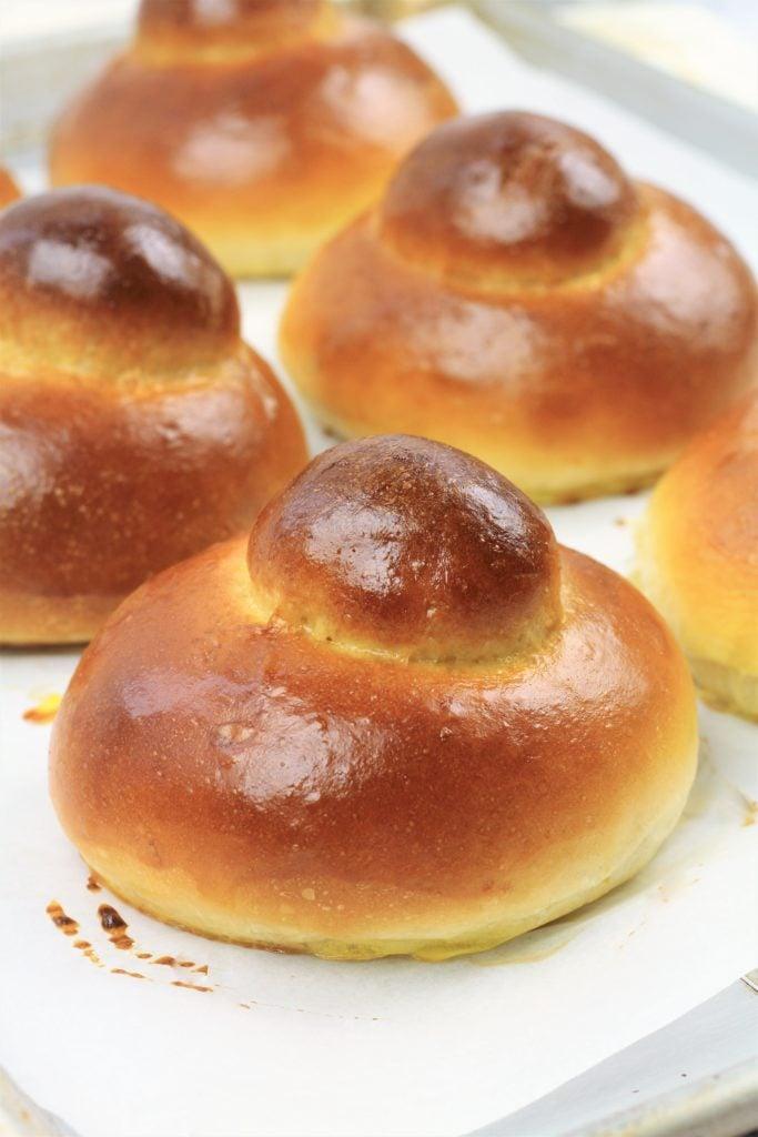 baked brioche on baking sheet