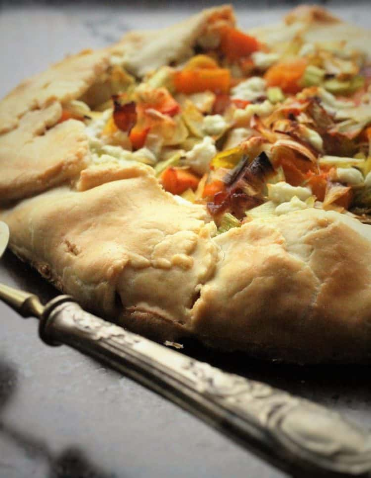 Savoury Butternut Squash, Leek and Goat Cheese Crostata  with serving spatula