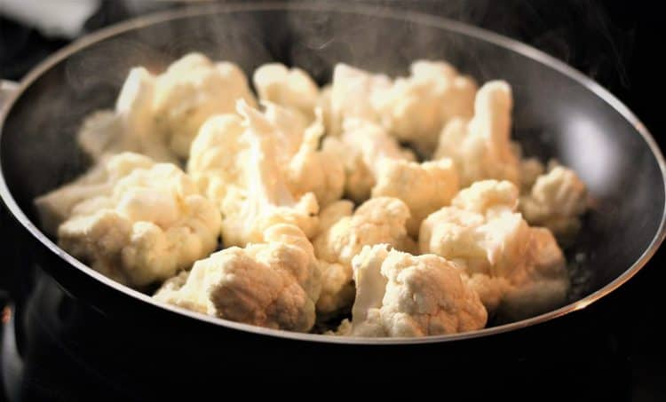 pan with boiling cauliflower florets