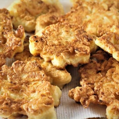 plate of cauliflower fritters on paper towels to absorb excess oil