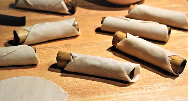 cannoli dough wrapped around dowels