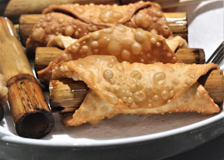fried cannoli shells wrapped around dowels