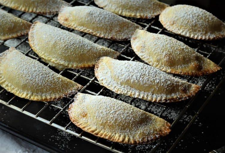 Sicilian Cassatelle with Ricotta on cooling rack
