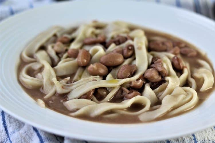 white bowl with tagliarini with beans