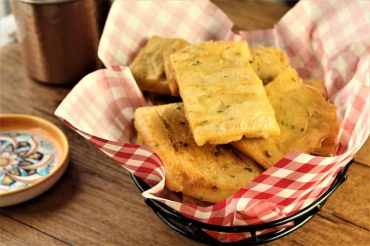 squares of panelle or chickpea fritters in a serving basket