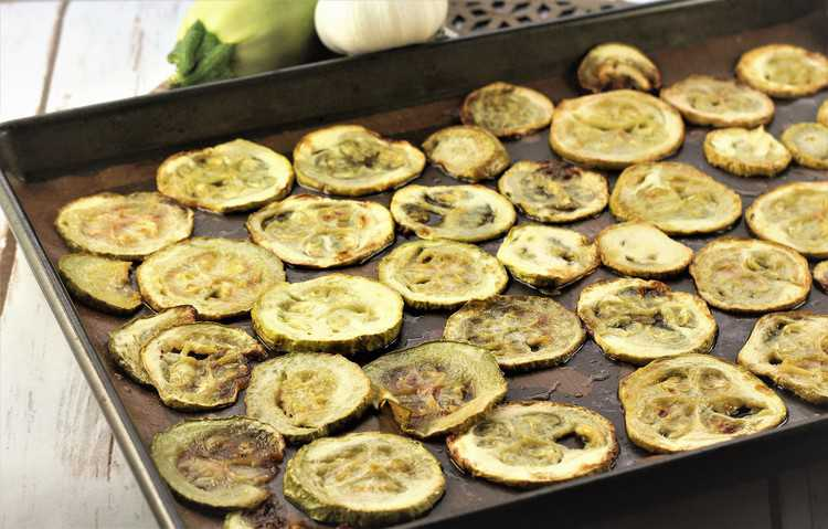 baking sheet filled with roasted zucchini rounds
