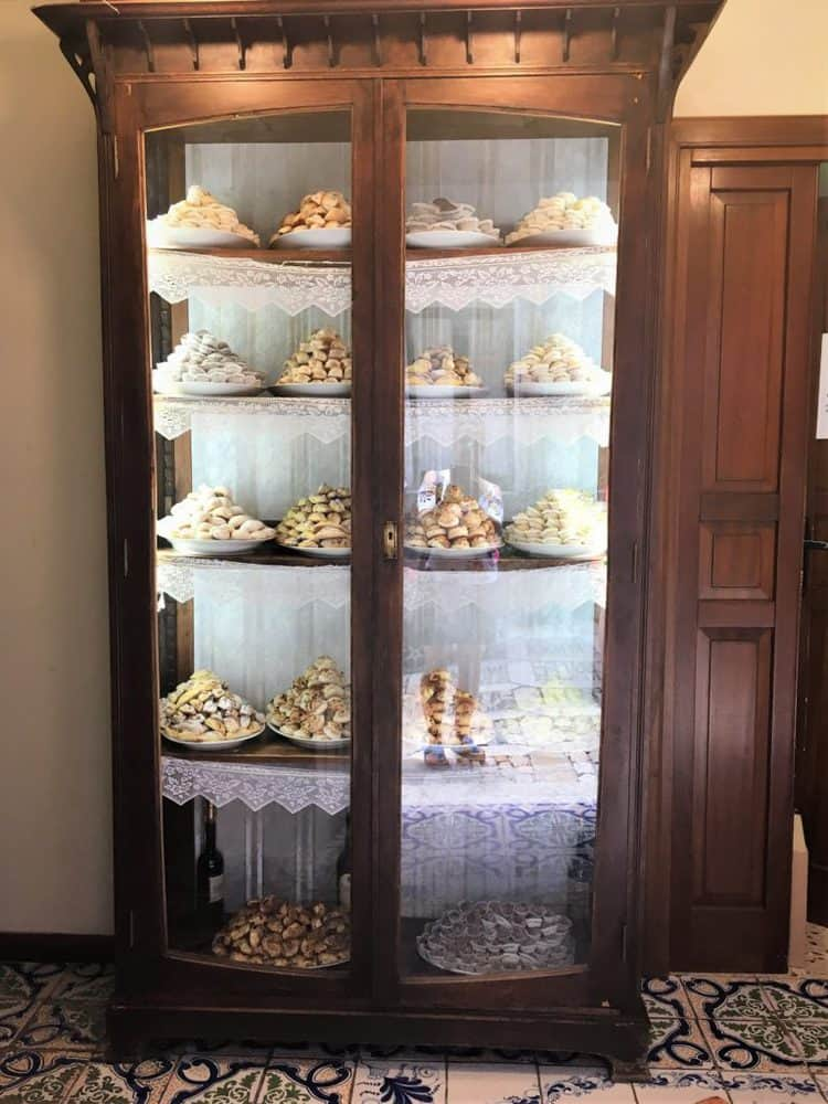 glass case filled with platters of cookies