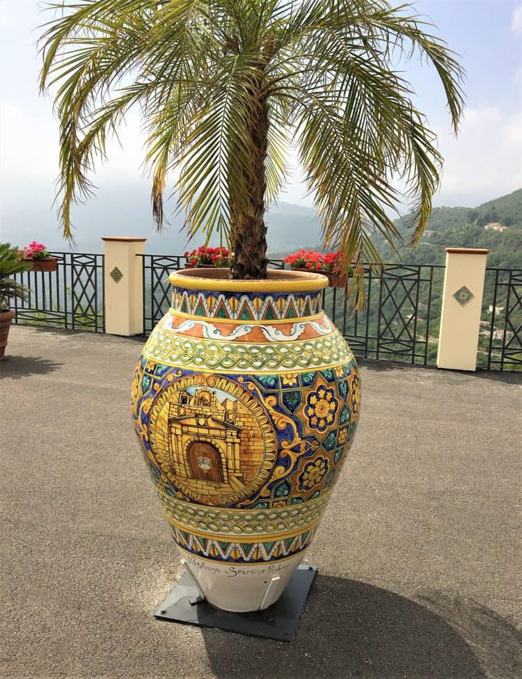 hand painted ceramic pot with palm tree in it
