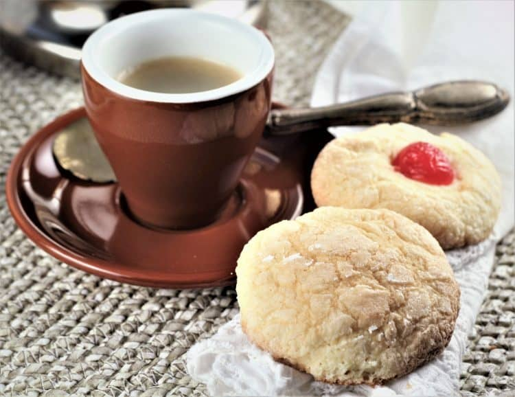 Italian orange juice cookies next to cup of espresso coffee