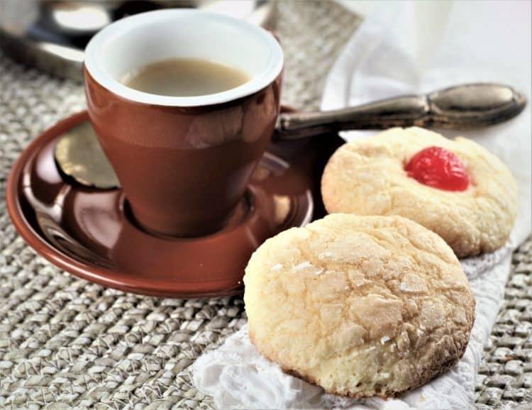 Italian orange juice cookies next to cup of espresso coffee
