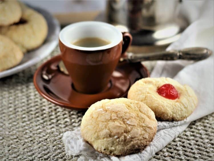 Italian Orange Juice Cookies next to cup of coffee