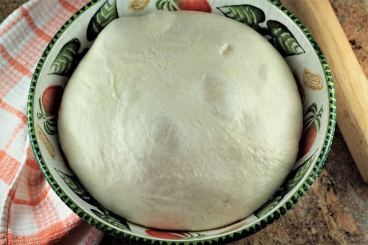 bowl of risen dough for Sicilian Sausage Bread (Bignolati)