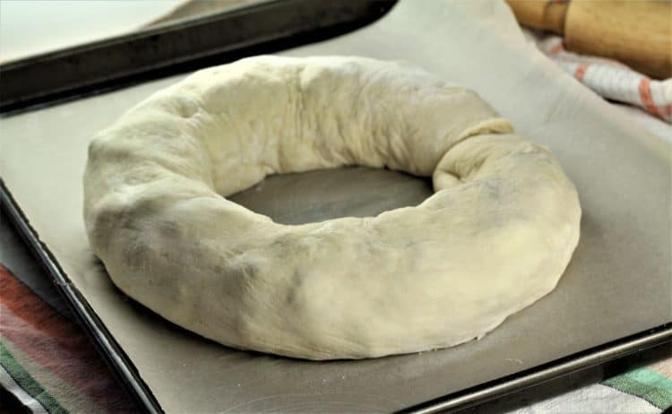 unbaked round Sicilian Sausage Bread (Bignolati)