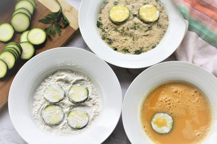 bowls with flour, eggs and breadcrumbs for dredging zucchini