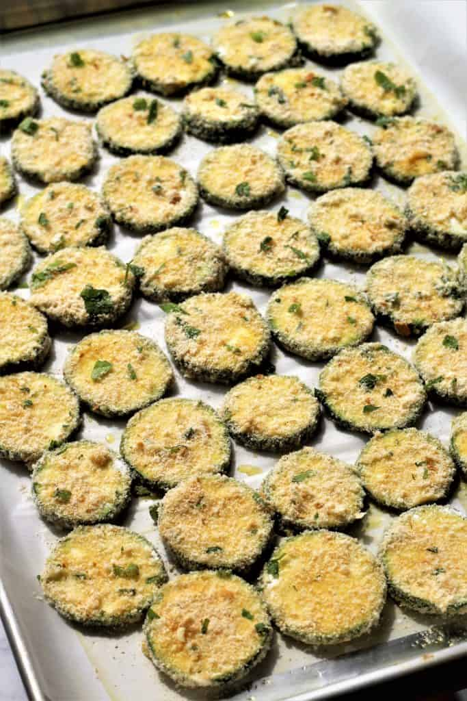 baking pan with prepared parmesan zucchini crisps ready for the oven