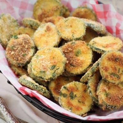 basket of Baked Zucchini Parmesan Crisps with forks on the side