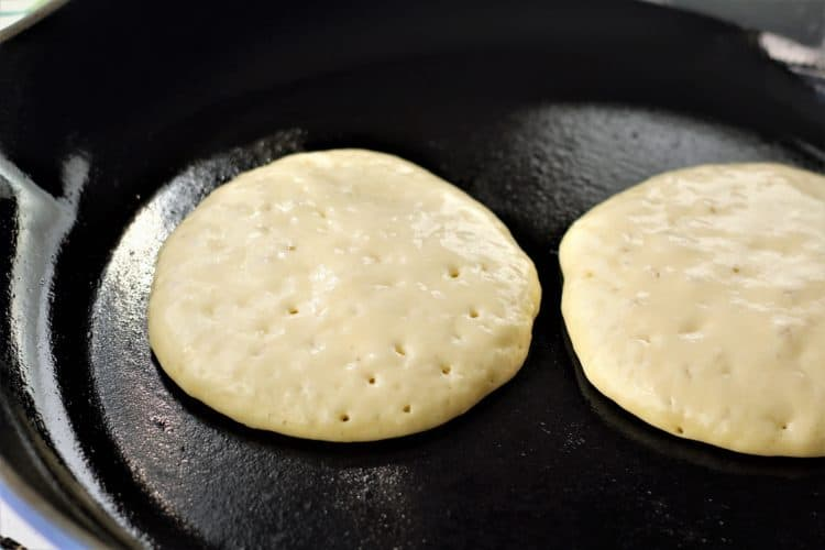 hot pan with 2 pancakes cooking