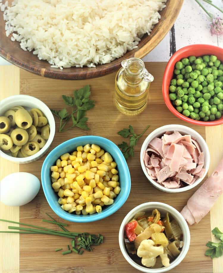 bowls with prepped ingredients for Italian rice salad