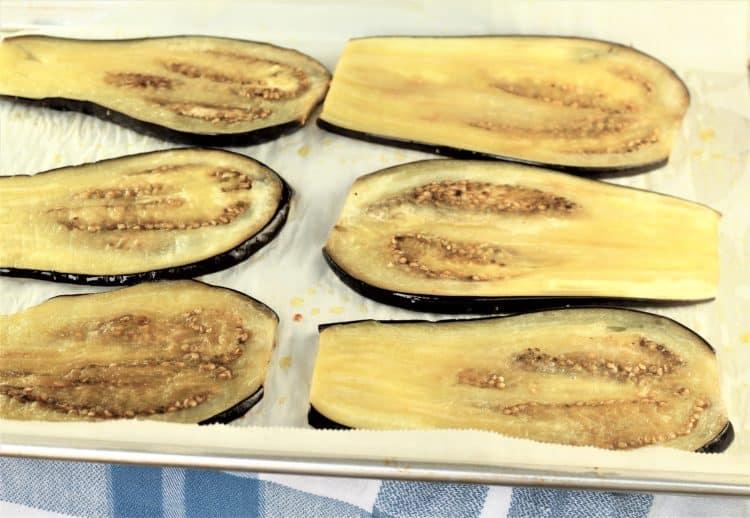 sliced roasted eggplant on a baking sheet