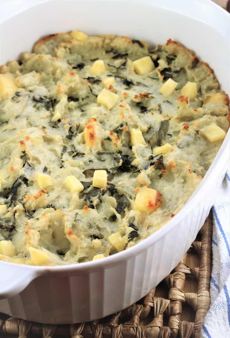 white casserole with cheesy swiss chard and potato casserole baked