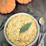 bowl of roasted pumpkin risotto with crispy sage leaf