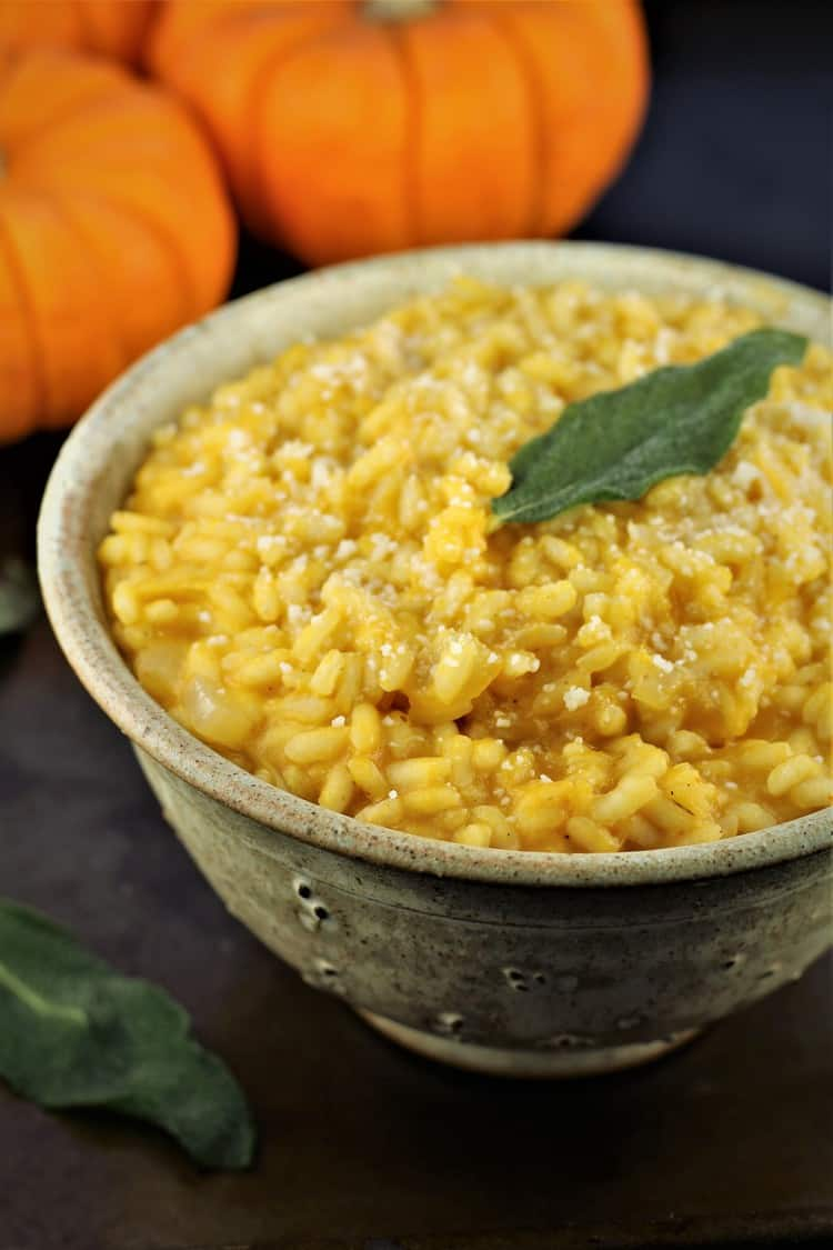 bowl of roasted pumpkin risotto with crispy sage leaf on top