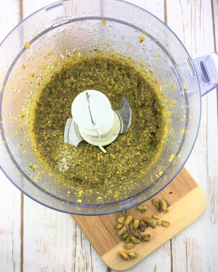 overhead view of food processor filled with pistachio pesto