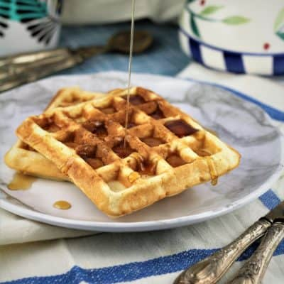 Yeasted Waffles drizzled with maple syrup