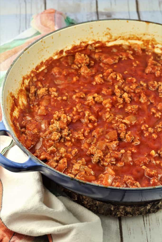 skillet filled with sausage tomato sauce