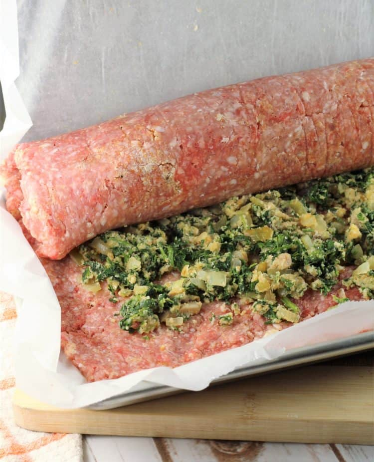 rollling a meatloaf on sheet pan with parchment paper
