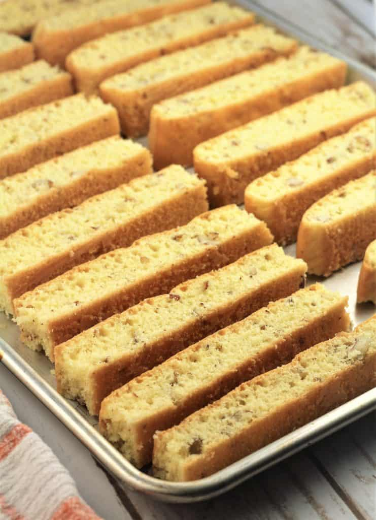 sliced almond biscotti on baking sheet