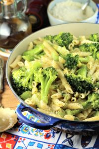 blue pan filled with pasta and broccoli