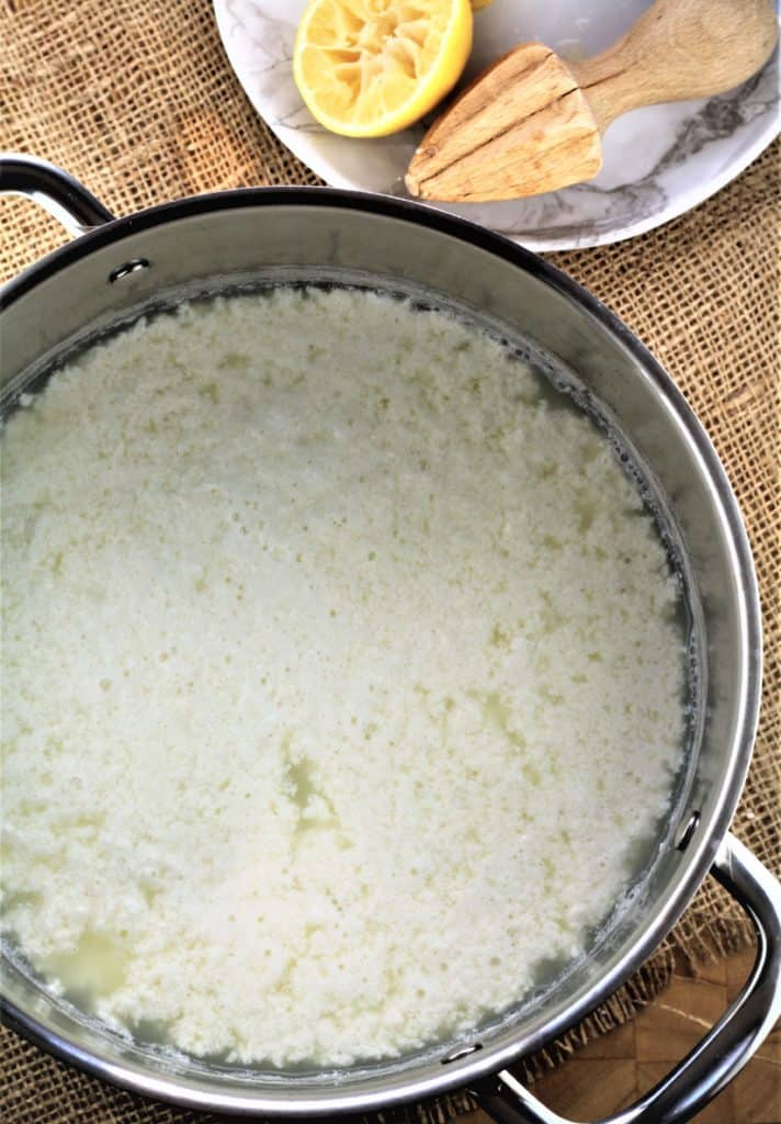 large pot filled with ricotta curds and whey