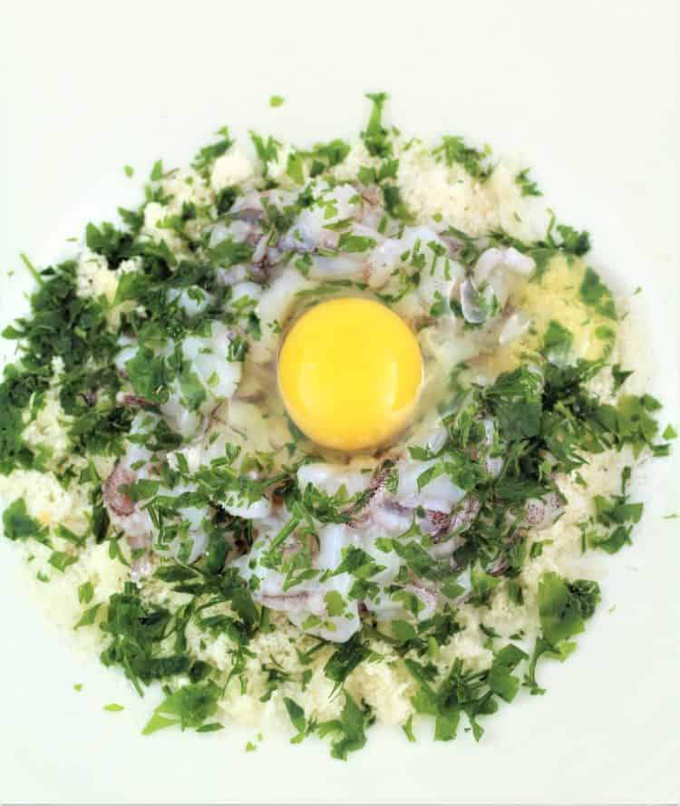 breadcrumbs, parsley and egg filling in bowl
