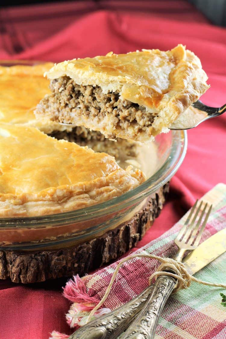 slice of tourtière being cut and served