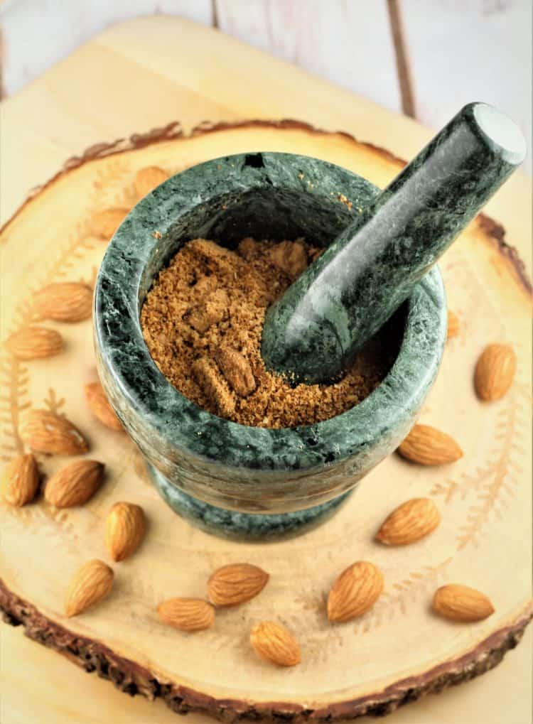 mortar and pestle with crushed almonds