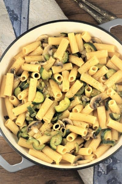 large skillet filled with zucchini mushroom pasta