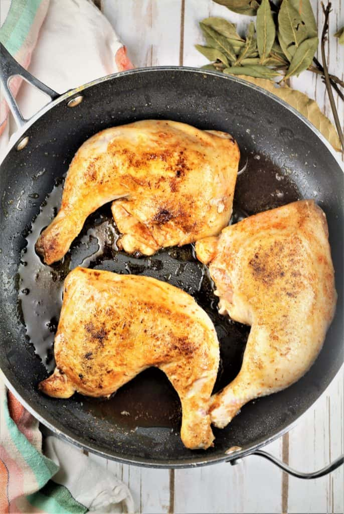 chicken legs browning in large skillet