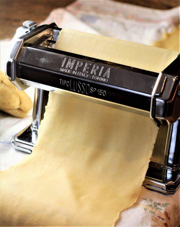 rolling dough for cassatelle in pasta maker