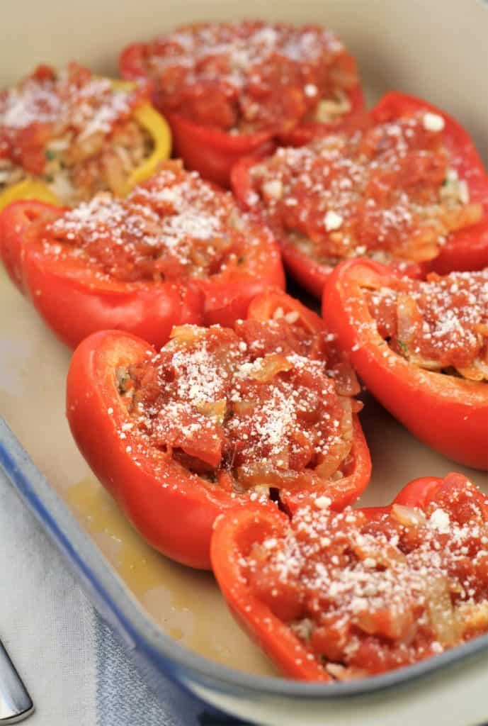 stuffed red pepper halves on baking pan