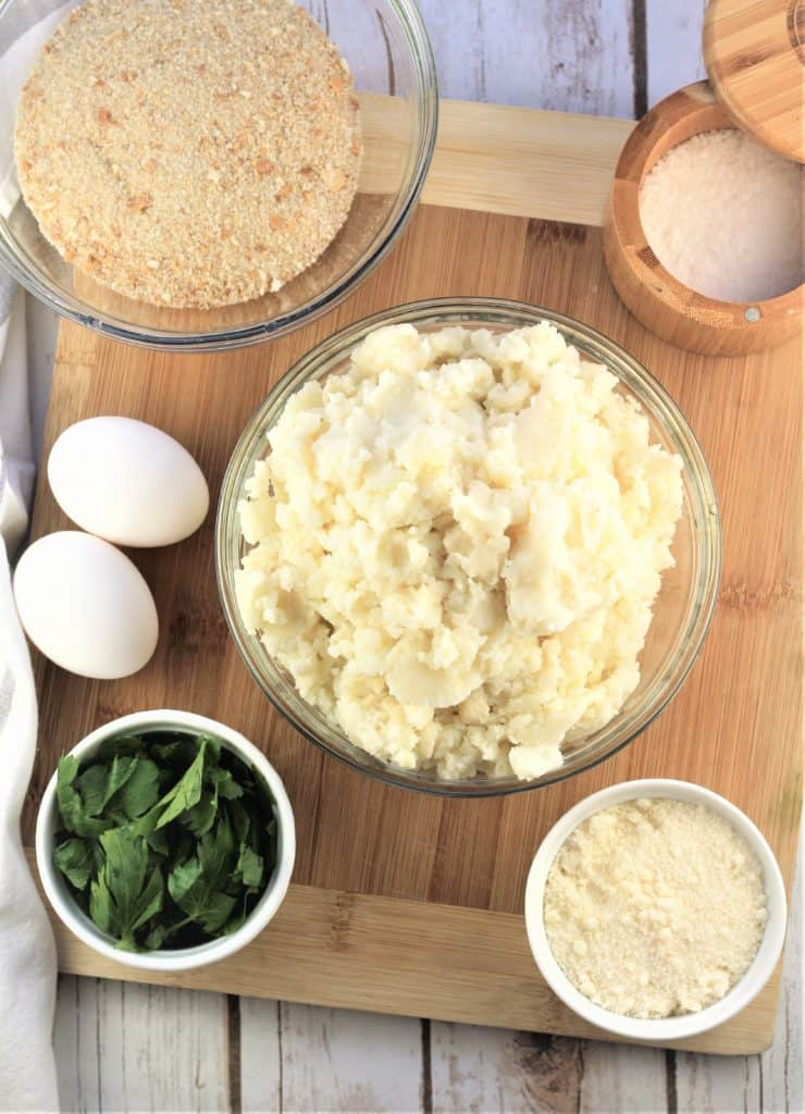 bowls with mashed potatoes, parsley, grated cheese, breadcrumbs, salt and 2 eggs