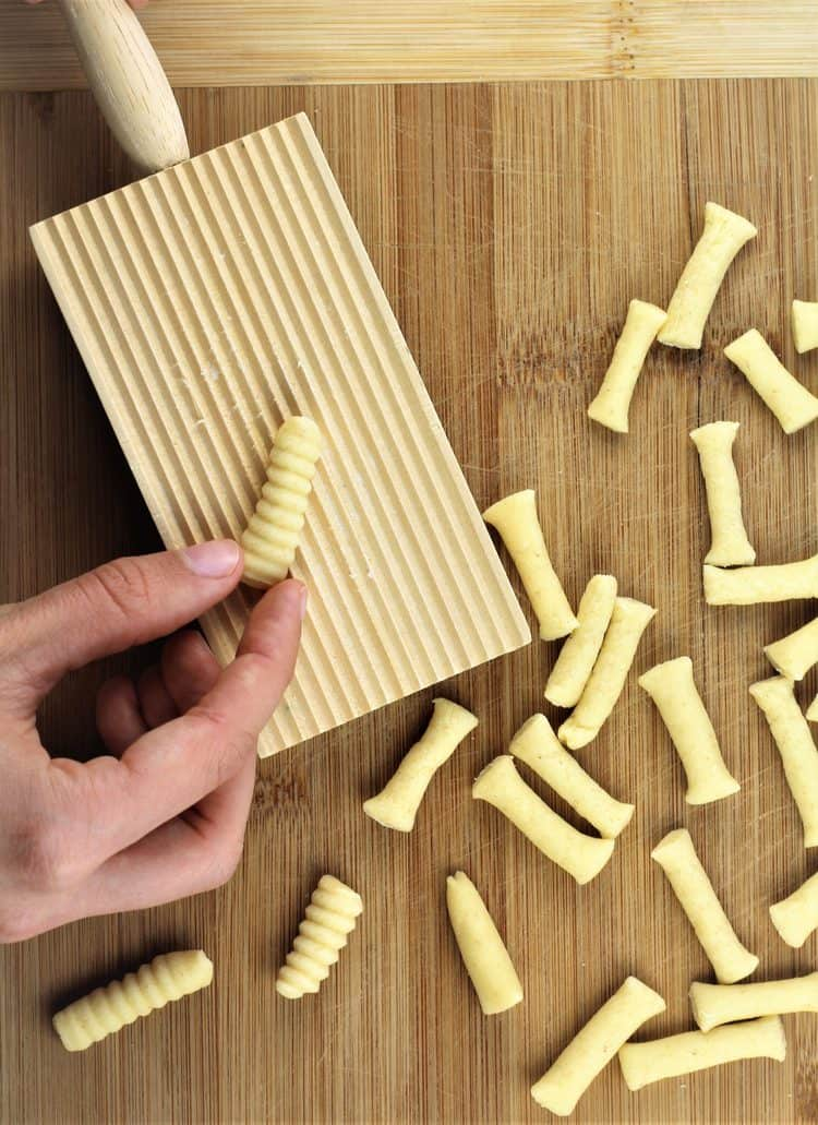 rolling cavatelli on a gnocchi board