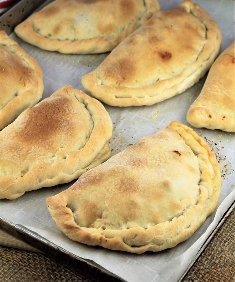 baking sheet filled with just baked calzone