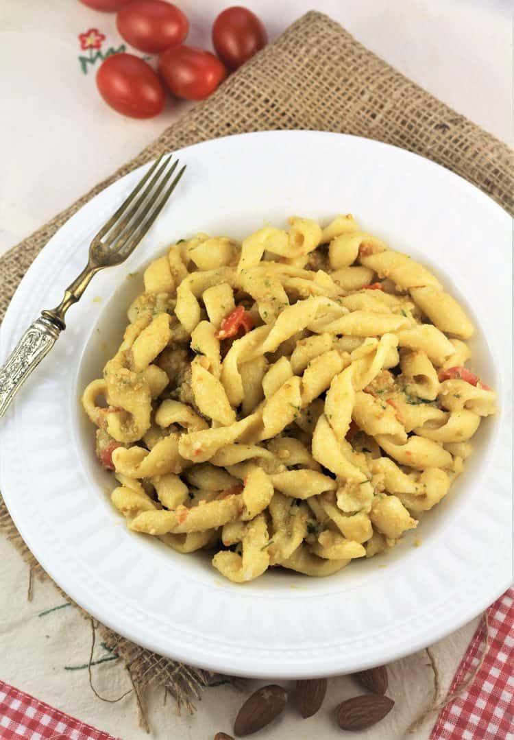 bowl of busiate pasta served with Pesto alla Trapanese (Sicilian Pesto)