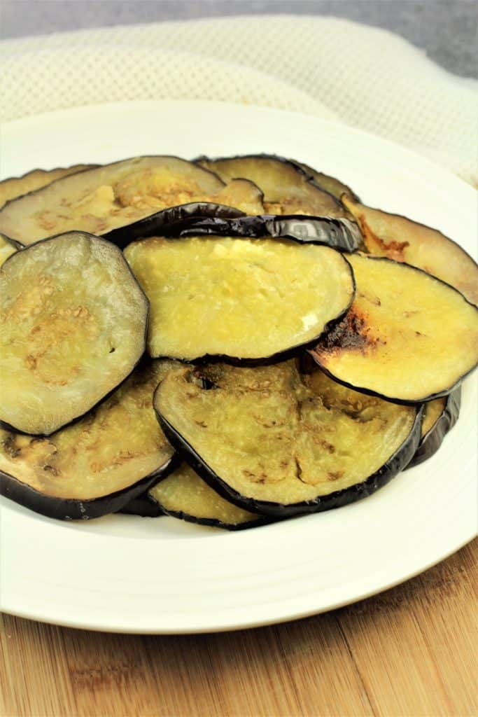 roasted eggplant rounds on white plate
